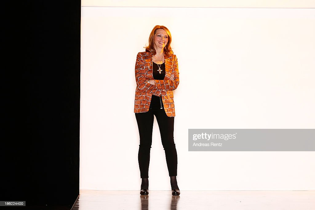 Designer Katya Rozhdestvenskaya appears at the end of the runway at the ROB-ART by Katya Rozhdestvenskaya show during Mercedes-Benz Fashion Week Russia S/S 2014 on October 29, 2013 in Moscow, Russia.