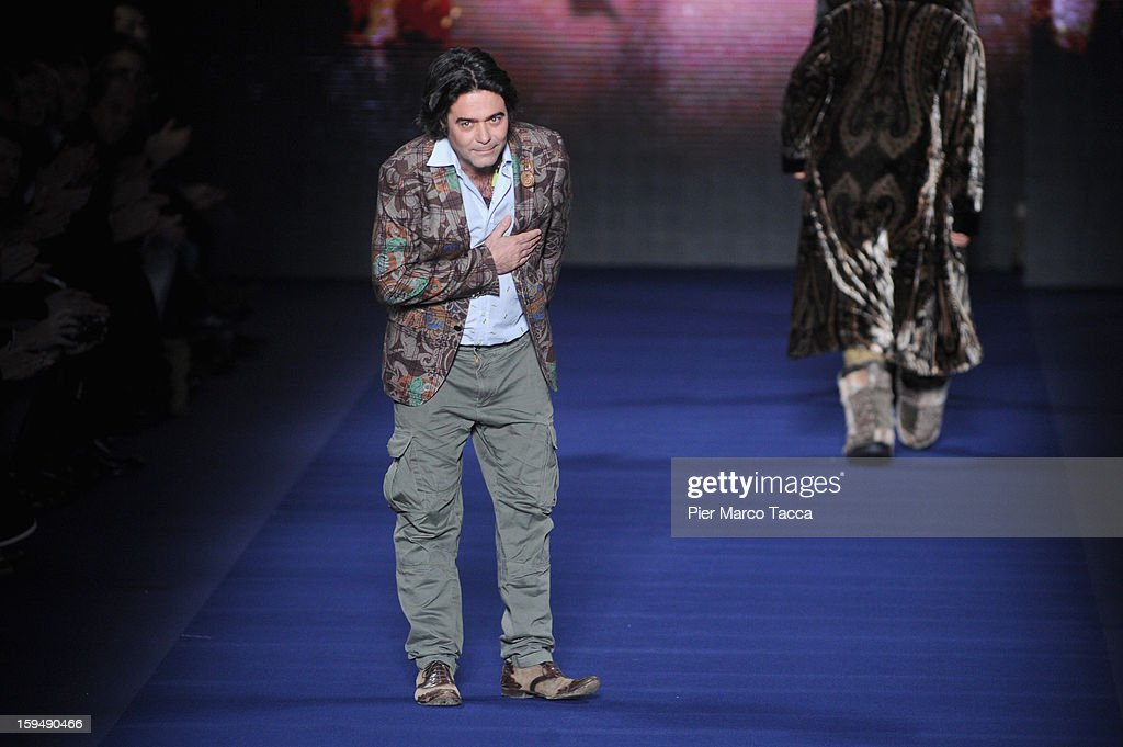 Designer <a gi-track='captionPersonalityLinkClicked' href=/galleries/search?phrase=Kean+Etro&family=editorial&specificpeople=2967727 ng-click='$event.stopPropagation()'>Kean Etro</a> acknowledges the applause of the audience after the Etro show as part of Milan Fashion Week Menswear Autumn/Winter 2013 on January 14, 2013 in Milan, Italy.