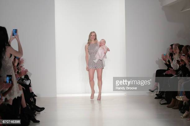 Designer Kelly Faetanini greets the audience after her Runway show for the Spring 2018 season during New York Fashion Week Bridal April 2017 at EZ...