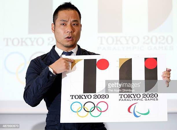 Designer Kenjiro Sano explains the design process for his emblem for the 2020 Tokyo Olympics at a news conference on August 5 2015 in Tokyo Japan The...