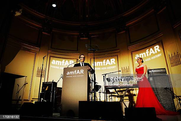 Designer Kenneth Cole and actress Uma Thurman speak on stage at the 4th Annual amfAR Inspiration Gala New York at The Plaza Hotel on June 13 2013 in...