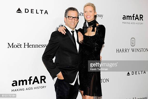 Designer Kenneth Cole and model Karolina Kurkova walk the red carpet of amfAR Milano 2016 at La Permanente on September 24 2016 in Milan Italy