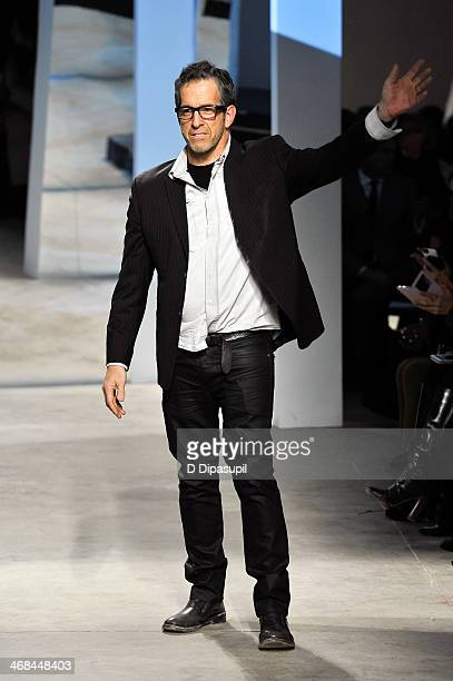 Designer Kenneth Cole greets the audience at the Kenneth Cole Collection fashion show during MercedesBenz Fashion Week Fall 2014 at The Garage By...