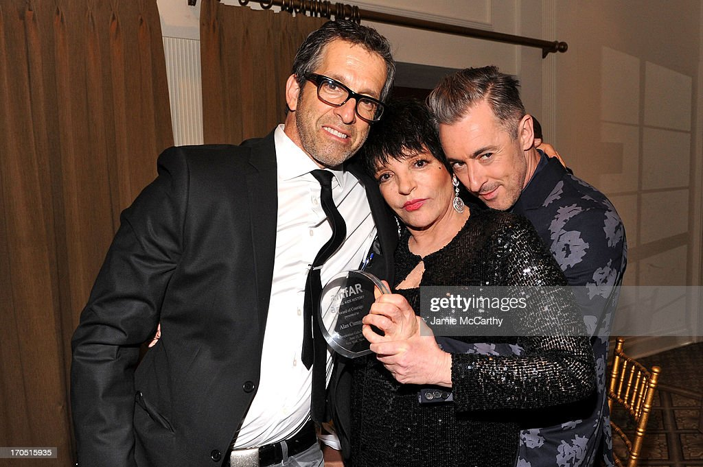 Designer Kenneth Cole, <a gi-track='captionPersonalityLinkClicked' href=/galleries/search?phrase=Liza+Minnelli&family=editorial&specificpeople=121547 ng-click='$event.stopPropagation()'>Liza Minnelli</a> and actor <a gi-track='captionPersonalityLinkClicked' href=/galleries/search?phrase=Alan+Cumming&family=editorial&specificpeople=202521 ng-click='$event.stopPropagation()'>Alan Cumming</a> performs during the 4th Annual amfAR Inspiration Gala New York at The Plaza Hotel on June 13, 2013 in New York City.