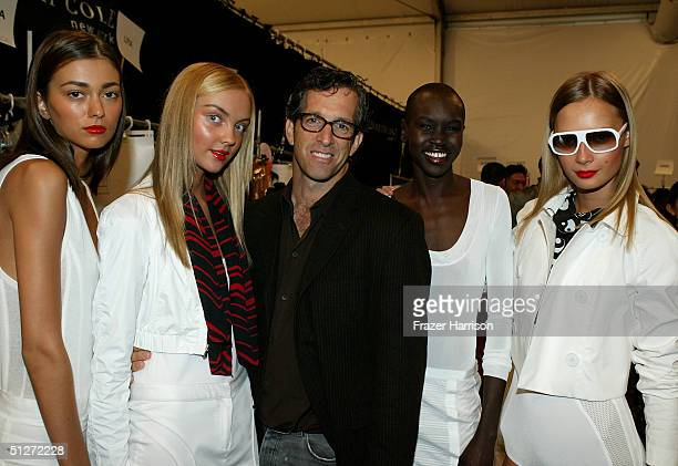 Designer Kenneth Cole poses with models as they stand backstage at the Kenneth Cole Spring 2005 fashion show during the Olympus Fashion Week Spring...