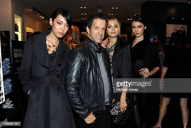 Designer Kenneth Cole poses with models at the Grand Opening of Kenneth Cole Boutique at Santa Monica Place on November 10 2010 in Santa Monica...