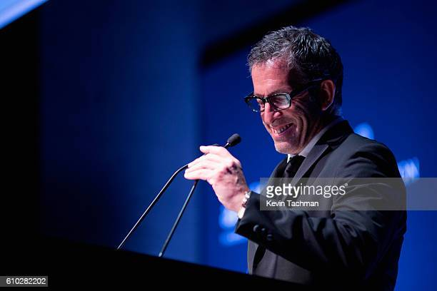 Designer Kenneth Cole presents on stage at the amfAR Milano 2016 at La Permanente on September 24 2016 in Milan Italy