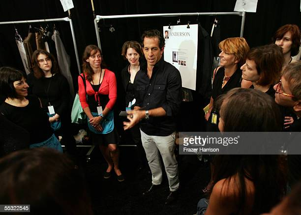 Designer Kenneth Cole talks backstage at the Kenneth Cole Spring 2006 fashion show during Olympus Fashion Week at Bryant Park September 9 2005 in New...