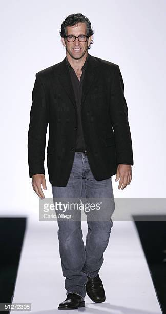 Designer Kenneth Cole walks down the runway at the Kenneth Cole Show during Olympus Fashion Week Spring 2005 in the Theater at Bryant Park September...