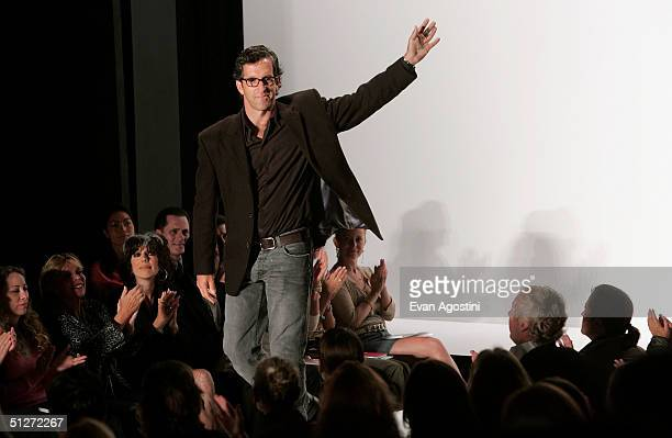 Designer Kenneth Cole waves as he stand on the runway during Kenneth Cole Spring 2005 fashion show during the Olympus Fashion Week Spring 2005 at...