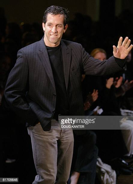 Designer Kenneth Cole waves at the end of his Fall 2002 fashion show in New York 15 February 2002 AFP PHOTO/Doug KANTER