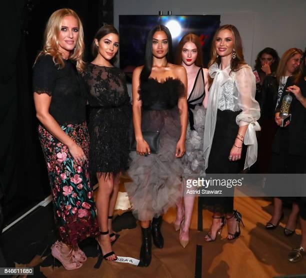 Designer Keren Craig Olivia Culpo Shanina Shaik Larsen Thompson and designer Georgina Chapman backstage for the Marchesa fashion show during New York...