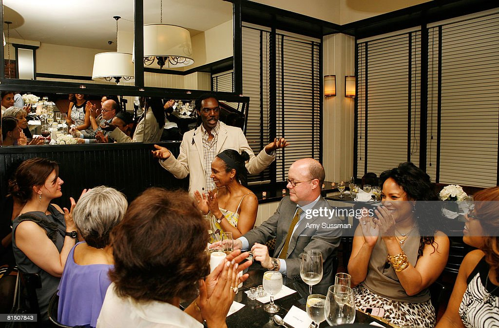 Designer Kevan Hall (center) gives toast at a celebration of Ruby Dee's style at Melba's restaurant on June 9, 2008 in New York City.