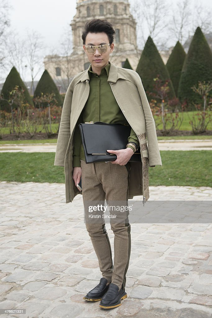 Designer Killian Young wears a Lanvin bag, Givency shirt and jacket, Celine trousers, Rick Owens shoes and Dolce and Gabbana sunglasses on day 4 of Paris Collections: Women on February 28, 2014 in Paris, France.