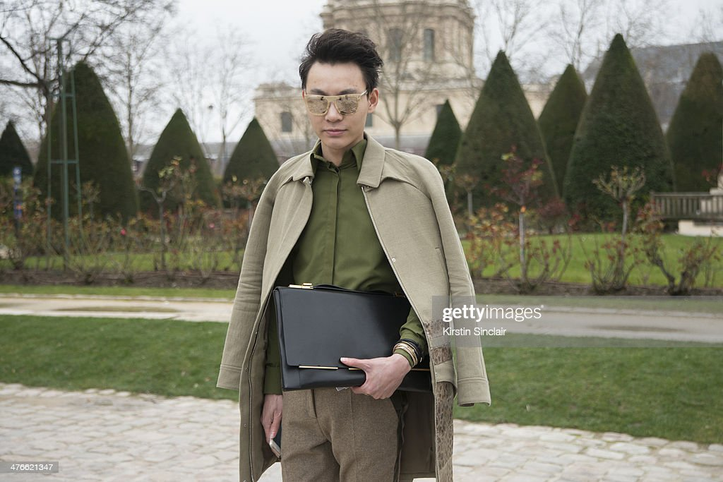 Designer Killian Young wears a Lanvin bag, Givency shirt and jacket, Celine trousers and Dolce and Gabbana sunglasses on day 4 of Paris Collections: Women on February 28, 2014 in Paris, France.