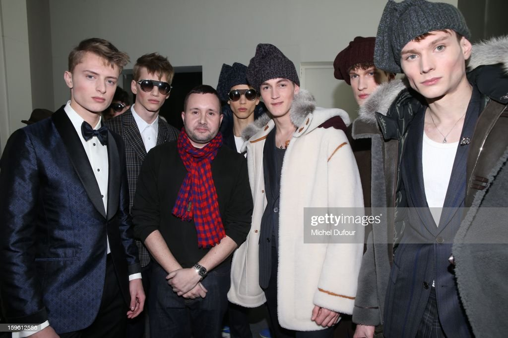 Designer Kim Jones and models pose after the Louis Vuitton Men Autumn / Winter 2013 show as part of Paris Fashion Week on January 17, 2013 in Paris, France.