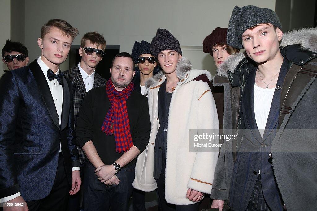 Designer Kim Jones and models pose after the Louis Vuitton Men Autumn / Winter 2013 show as part of Paris Fashion Week on January 17, 2013 in Paris, France.