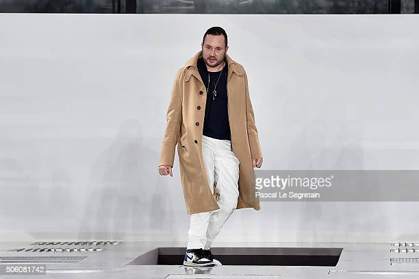 Designer Kim Jones poses on the runway during the Louis Vuitton Menswear Fall/Winter 20162017 show as part of Paris Fashion Week on January 21 2016...