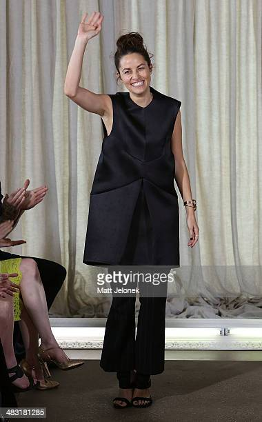 Designer Kym Ellery acknowledges the audience at the Ellery show during MercedesBenz Fashion Week Australia 2014 at Bondi Icebergs on April 7 2014 in...