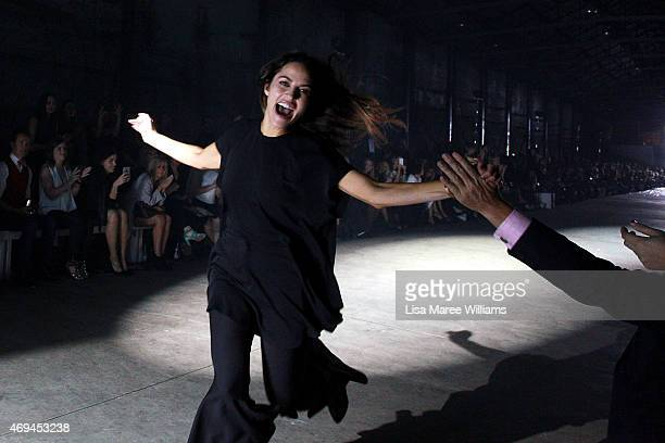 Designer Kym Ellery thanks the audience after the MercedesBenz Presents Ellery show at MercedesBenz Fashion Week Australia 2015 at Carriageworks on...