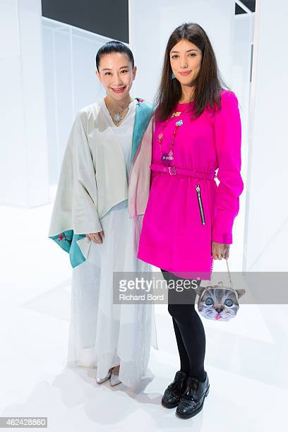 Designer Lan Yu and actress Vanessa Guide attend the Lan Yu show as part of the Paris Fashion Week Haute Couture Spring/Summer 2015 at the Grand...