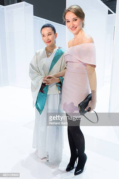 Designer Lan Yu and Deborah Francois attend the Lan Yu show as part of the Paris Fashion Week Haute Couture Spring/Summer 2015 at the Grand Palais on...