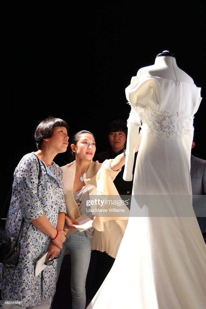 Designer Lan Yu and Editorinchief of Vogue China Angelica Cheung view an outfit ahead of the Lan Yu show during MercedesBenz Fashion Week Australia...