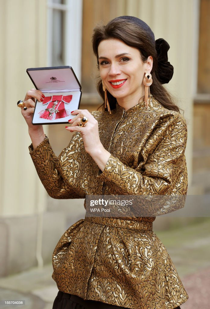 Designer Lara Bohinc holds her member of the British Empire (MBE) medal following an Investiture Ceremony hosted by the Princess Royal at Buckingham Palace on November 7, 2012 in London, England.
