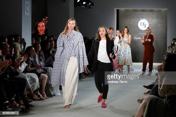 Designer Lara Krude is seen with a model on the runway after accepting the fashion talent award 'Designer for Tomorrow' by Peek Cloppenburg and...