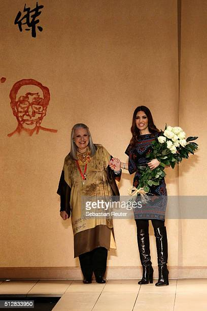 Designer Laura Biagiotti and her daughter Lavinia Biagiotti ackowledge the applause of the audience at the end of the Laura Biagiotti show during...