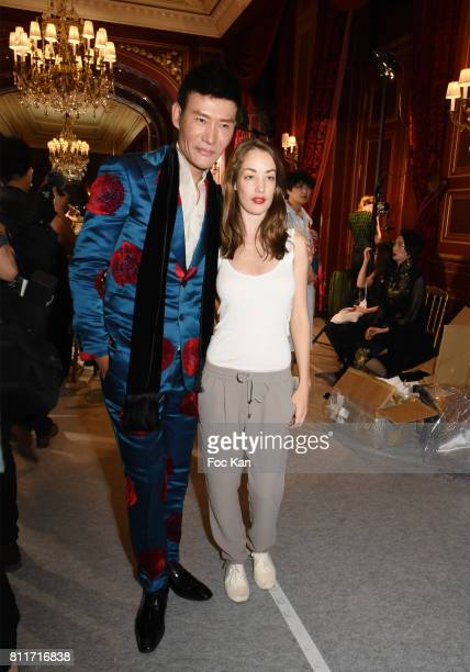 Designer Laurence Xu and actress Juliette Besson attend the Laurence Xu Haute Couture Fall/Winter 20172018 show as part of Haute Couture Paris...