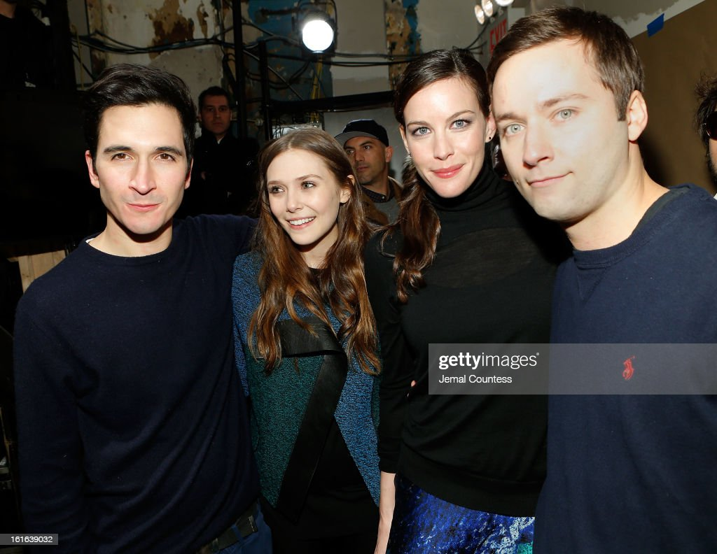 Designer Lazaro Hernandez, actress Elizabeth Olson, actress Liv Tyler and designer Jack McCollough backstage at the Prenza Schouler fall 2013 fashion show during Mercedes-Benz Fashion Week on February 13, 2013 in New York City.