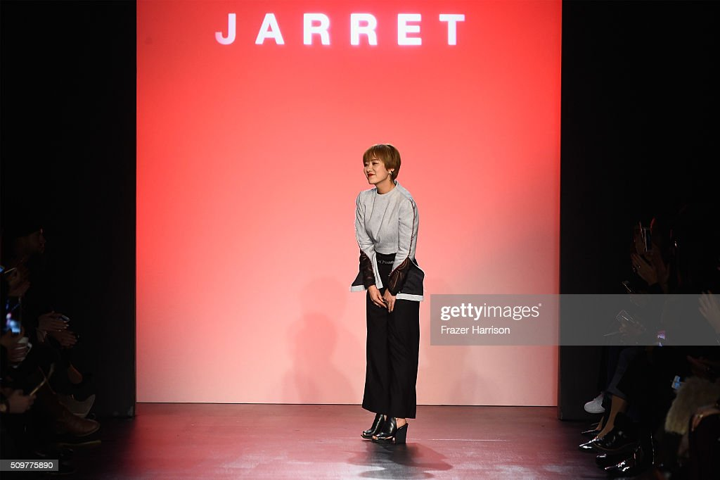 Designer Lee Ji Yeon greets the audience from the runway wearing Concept Korea Fall 2016 during New York Fashion Week: The Shows at The Dock, Skylight at Moynihan Station on February 12, 2016 in New York City.