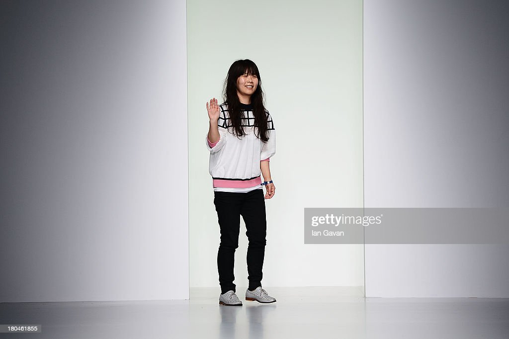 Designer Lee Jung-sun acknowledges the crowd following her J. JS Lee show during London Fashion Week SS14 at BFC Courtyard Showspace on September 13, 2013 in London, England.