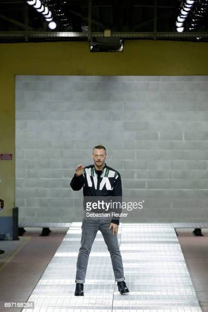 Designer Lee Wood acknowledges the applause of the audience after the Dirk Bikkembergs show during Milan Men's Fashion Week Spring/Summer 2018 on...