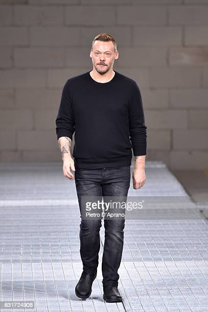 Designer Lee Wood acknowledges the applause of the audience at the Dirk Bikkembergs show during Milan Men's Fashion Week Fall/Winter 2017/18 on...