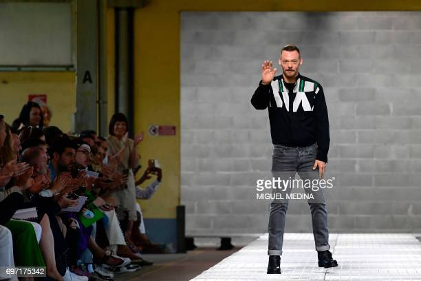 Designer Lee Wood greets the audience at the end of the show for fashion house Dirk Bikkembergs during the Men's Spring/Summer 2018 fashion shows in...