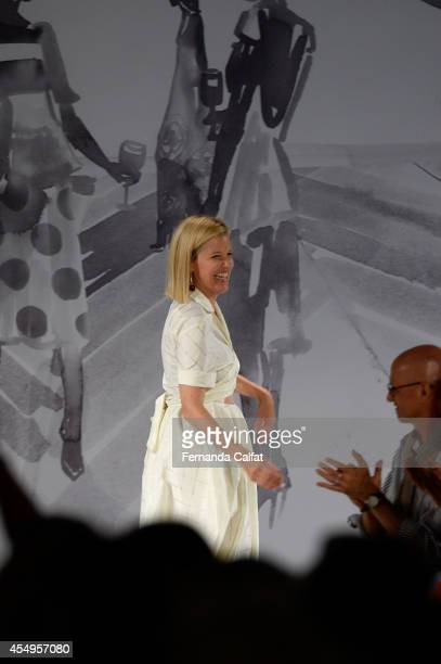 Designer Lela Rose greets the audience at the Lela Rose fashion show during MercedesBenz Fashion Week Spring 2015 at The Pavilion at Lincoln Center...