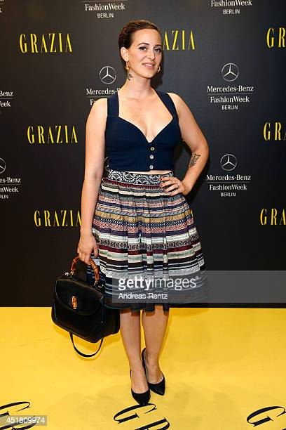Designer Lena Hoscheck arrives for the Opening Night by Grazia fashion show during the MercedesBenz Fashion Week Spring/Summer 2015 at Erika Hess...