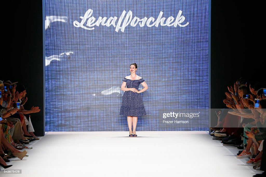 Designer Lena Hoschek acknowledges the applause of the audience after her show during the Mercedes-Benz Fashion Week Berlin Spring/Summer 2017 at Erika Hess Eisstadion on June 30, 2016 in Berlin, Germany.