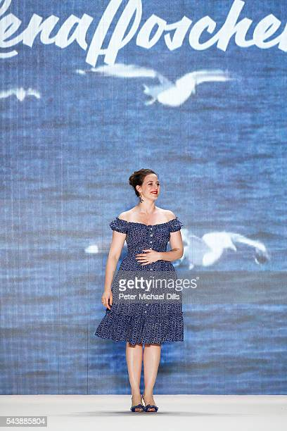 Designer Lena Hoschek acknowledges the applause of the audience after her show during the MercedesBenz Fashion Week Berlin Spring/Summer 2017 at...