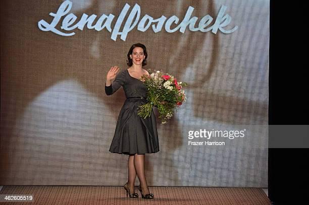 Designer Lena Hoschek acknowledges the audience after the Lena Hoschek show during MercedesBenz Fashion Week Autumn/Winter 2014/15 at Brandenburg...