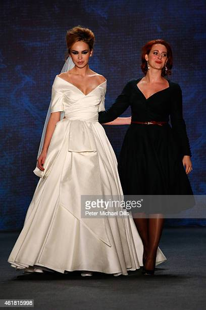 Designer Lena Hoschek and a model on the runway after the Lena Hoschek show during the MercedesBenz Fashion Week Berlin Autumn/Winter 2015/16 at...