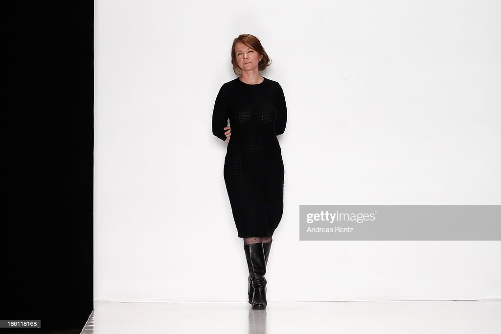 Designer Lena Tsokalenko appear at the end of the runway at the Lena Tsokalenko show during Mercedes-Benz Fashion Week Russia S/S 2014 on October 28, 2013 in Moscow, Russia.