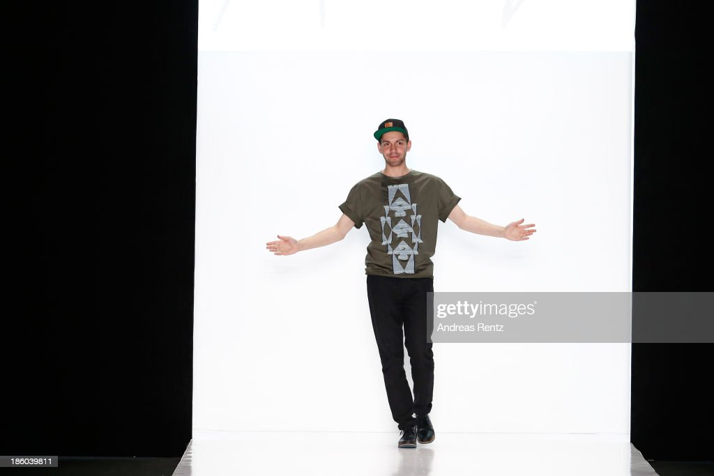 Designer Leonid Alexeev on the runway after the Leonid Alexeev show during Mercedes-Benz Fashion Week Russia S/S 2014 on October 27, 2013 in Moscow, Russia.