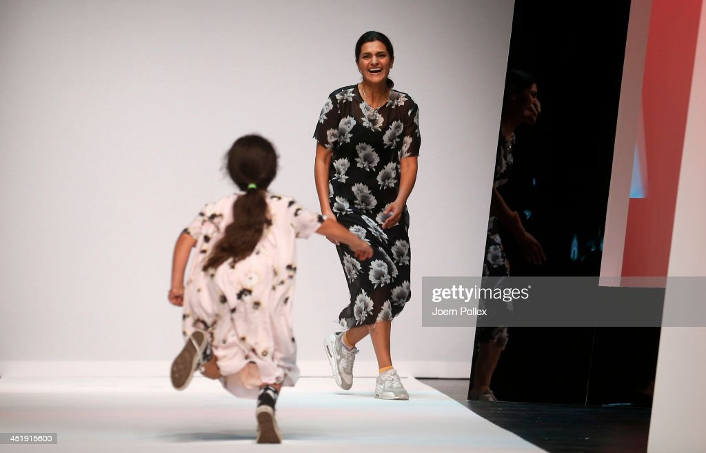 Designer Leyla Piedayesh acknowledges the audience after the LaLa Berlin show during the MercedesBenz Fashion Week Spring/Summer 2015 at Tischlerei...