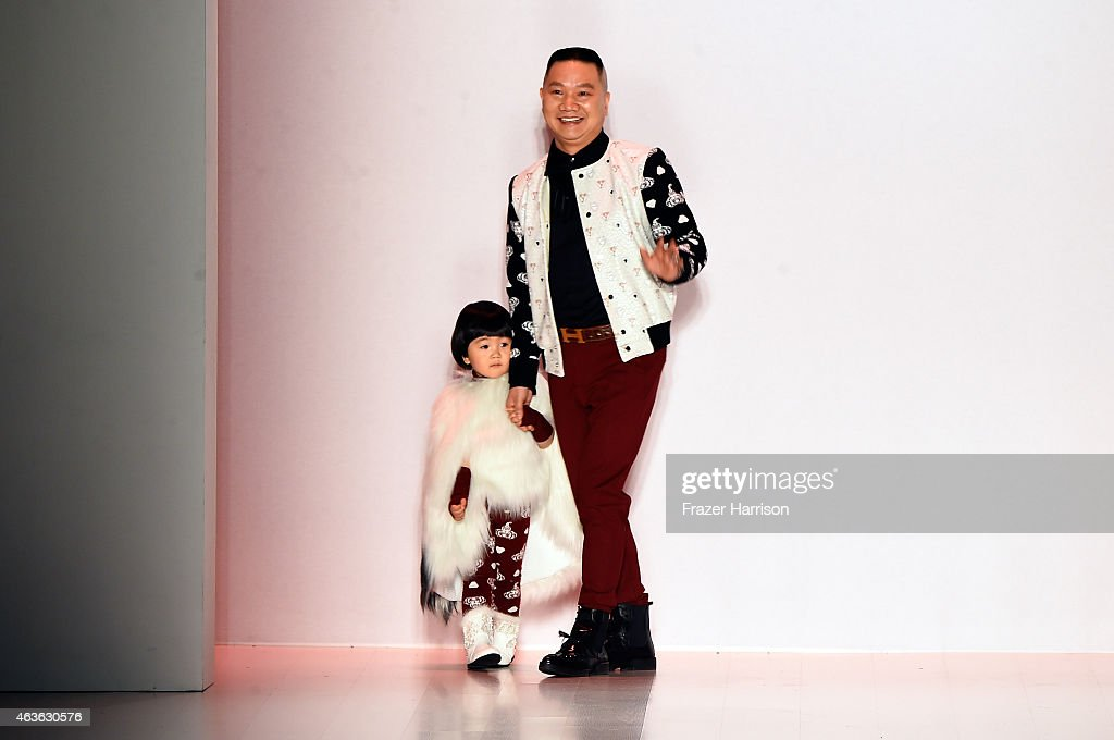 Designer Li Zuliang and his child walk the runway at the Oudifu fashion show during Mercedes-Benz Fashion Week Fall 2015 at The Salon at Lincoln Center on February 16, 2015 in New York City.