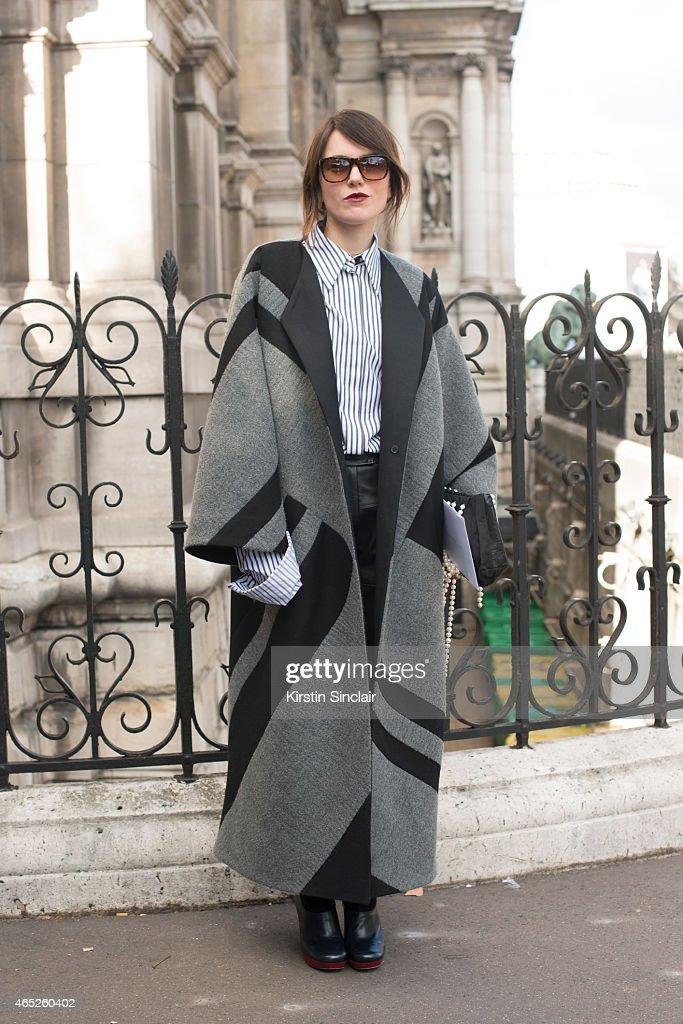 Designer Lilia Litkovstaya wears a Litkovstaya coat, Celine shoes, Litkovstaya shirt and Jill Sander glasses on day 2 of Paris Collections: Women on March 04, 2015 in Paris, France.