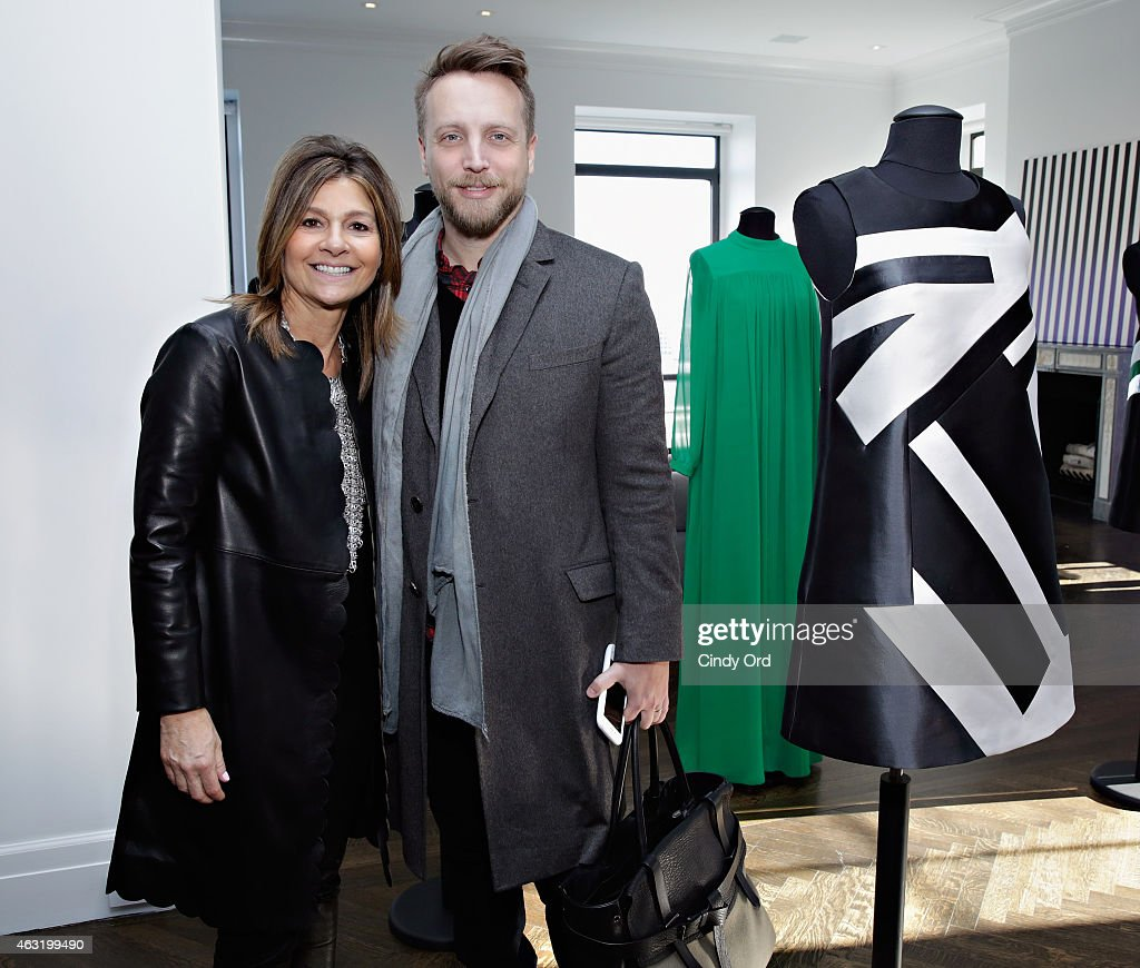 Designer Lisa Perry posses for a photo with editor of Time Inc's InStyle Ariel Foxman at the Lisa Perry Presentation during MercedesBenz Fashion Week...