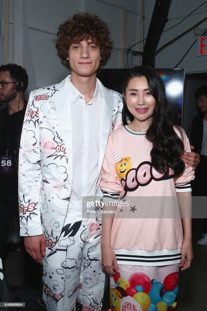 Designer Liu Jia and a model pose backstage for the Jia Liu fashion show during New York Fashion Week: The Shows at Gallery 2, Skylight Clarkson Sq on September 13, 2017 in New York City.